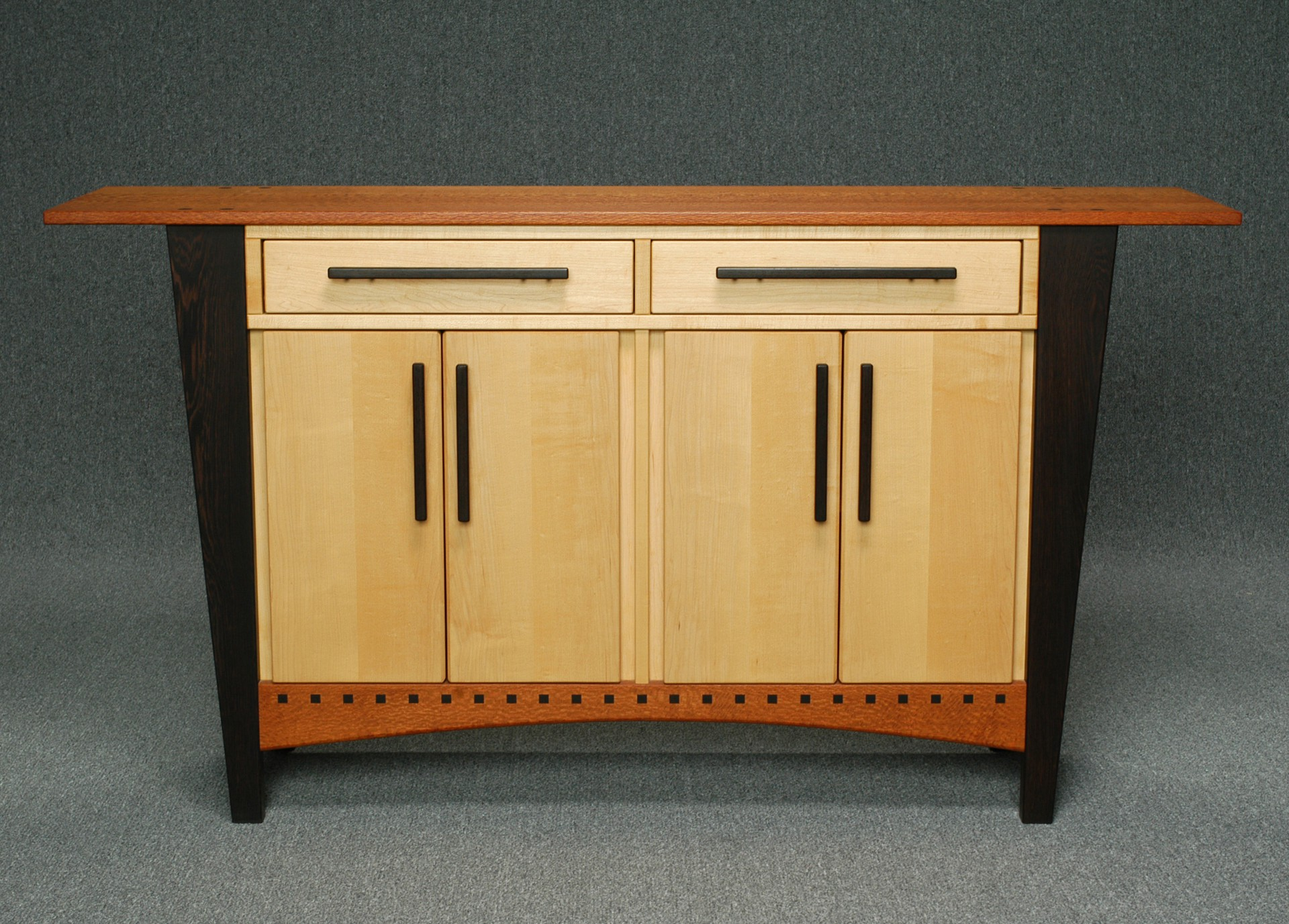Cabinet with tapered legs Image
